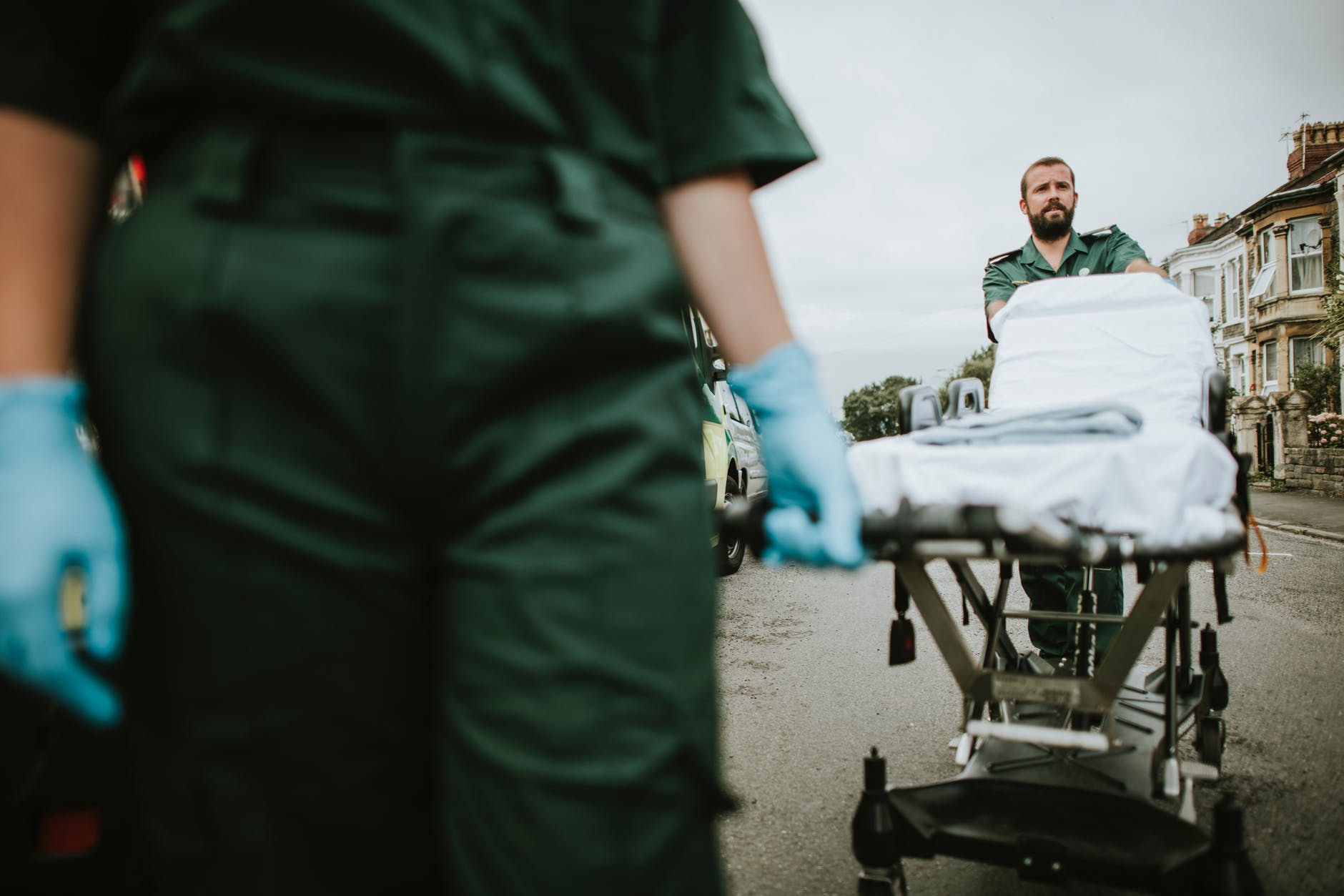 man pushing hospital bed